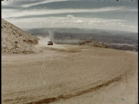 WS Auto racer Nick Parsons turning up hill in cloud of dust during a race/ Pike's Peak Colorado