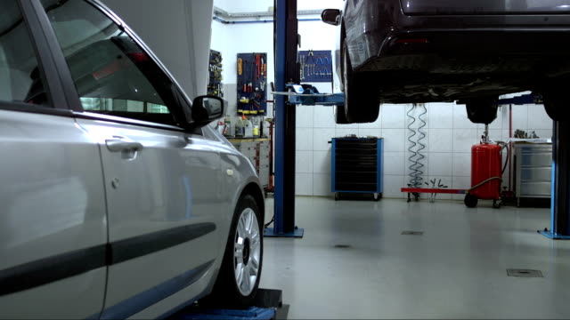 auto repair shop - repair garage stock videos & royalty-free footage