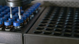 Auto sampler takes a vial and injects a sample into high performance liquid chromatography.