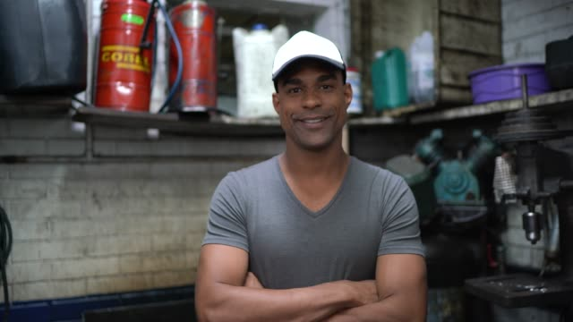 auto service latin afro worker / owner - pardo brazilian stock videos & royalty-free footage