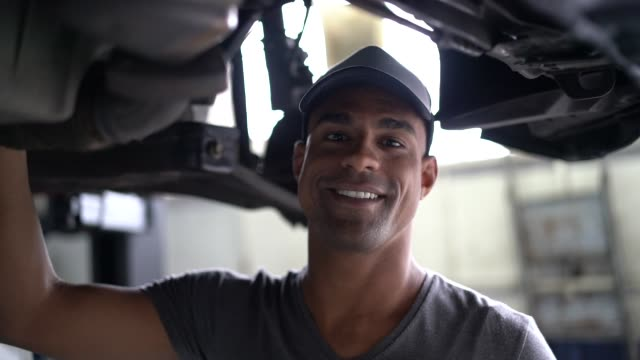 auto service latin afro worker / owner - etnia latino americana video stock e b–roll