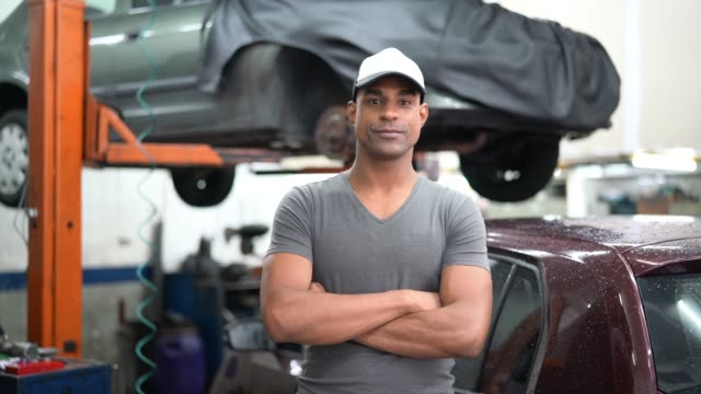 auto service latin afro worker / owner - arms crossed stock videos & royalty-free footage