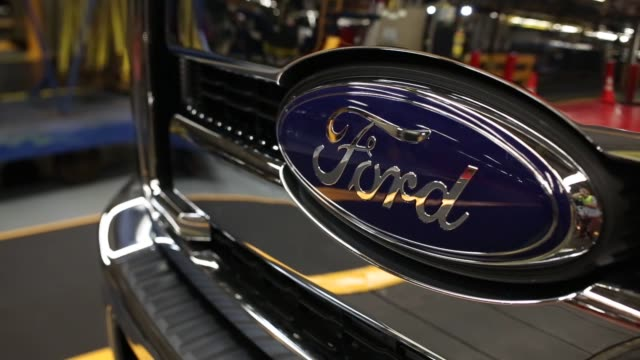 auto workers assemble ford super duty series pickup trucks on an assembly line at the ford motor co kentucky truck plant in louisville kentucky us on... - ford motor company stock videos & royalty-free footage