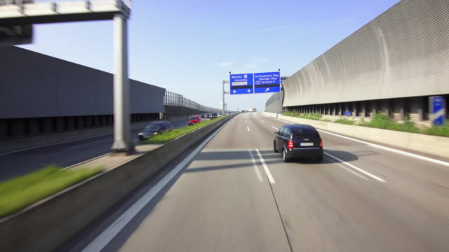 pov autobahn drive in munich - major road stock videos & royalty-free footage