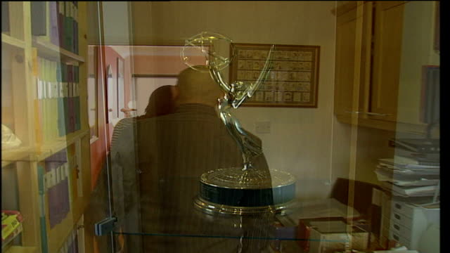 autograph collection owned by alan robinson up for auction; robinson and reporter along awards in glass cabinet belonging to sir john gielgud... - john gielgud stock videos & royalty-free footage