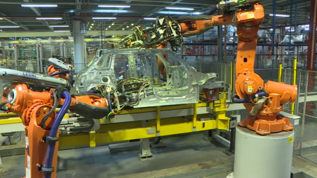 automated bmw mini car production line cowley oxford - production line stock videos & royalty-free footage