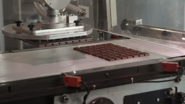 automated chocolate production line - chocolate factory stock videos & royalty-free footage