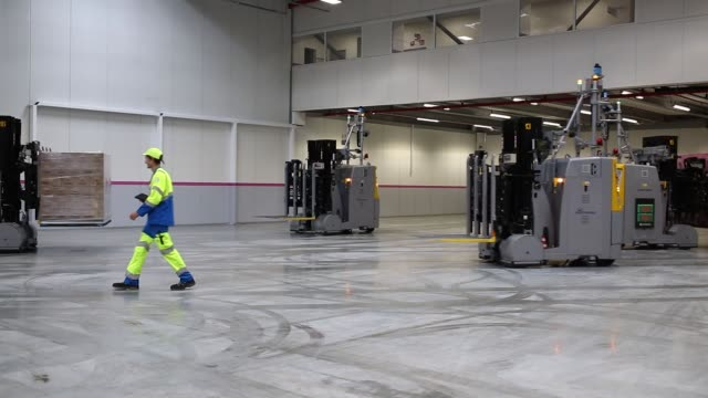 automated forklifts operate at the new evian mineral water bottling plant, owned by danone sa, near evian, france, on tuesday, sept. 12, 2017 - 純水点の映像素材/bロール