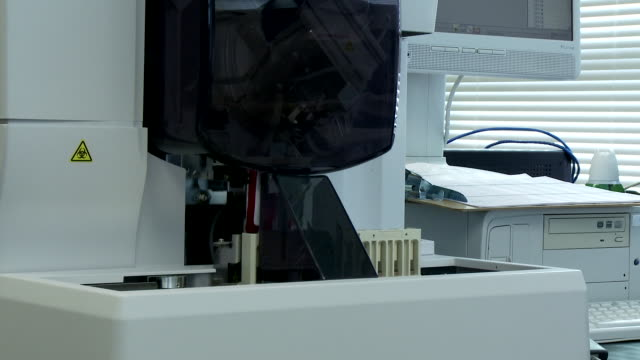 automated machine for blood testing - biohazard symbol stock videos and b-roll footage