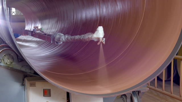 automated machine is painting the rotating pipe from inside - storage tank stock videos and b-roll footage