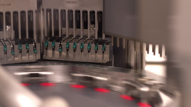 automated machine sorting medicine capsules - laboratory stock-videos und b-roll-filmmaterial