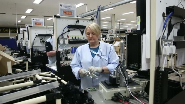 vídeos de stock e filmes b-roll de automated printing machinery operates on the production line at sony corp's technology centre in pencoed uk on monday dec 16 an employee oversees the... - sony