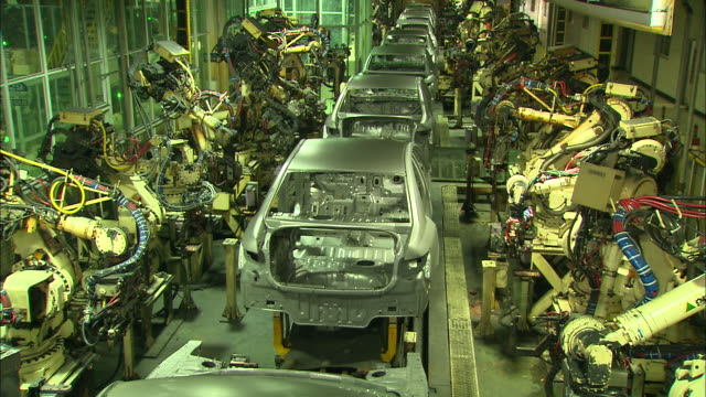 automated production line in car factory - automobile industry video stock e b–roll