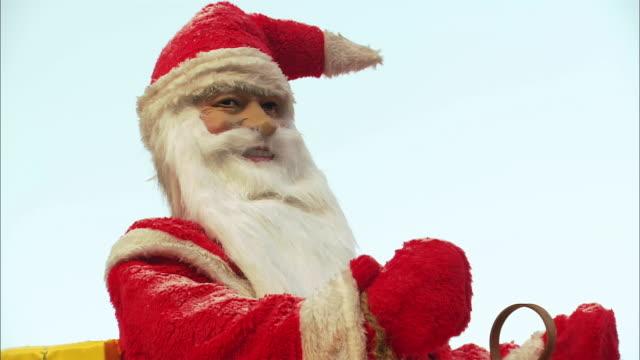 cu automated santa claus decoration / nuremberg, bavaria, germany - male likeness stock videos & royalty-free footage