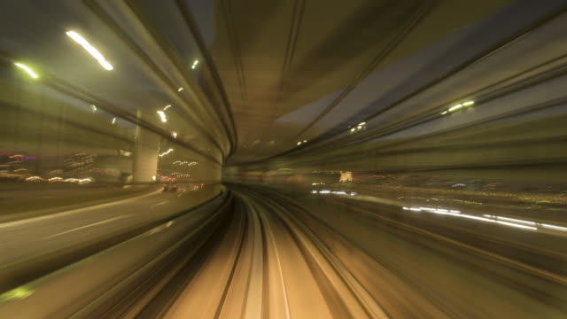automated train in tokyo 4k time lapse - distorto video stock e b–roll