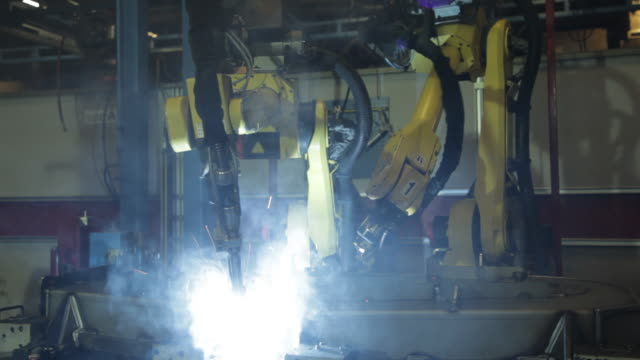 automated welding on the assembly line of a us manufacturing facility. - metal industry stock videos and b-roll footage
