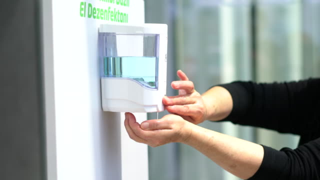 automatic alcohol dispenser in the hospital - surrounding wall stock videos & royalty-free footage