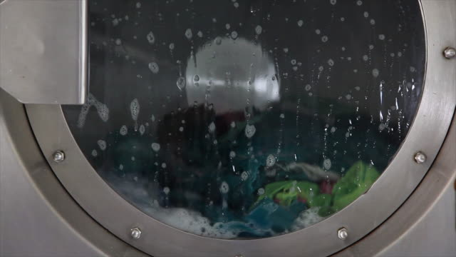 automatic clean washing machine. - launderette stock videos & royalty-free footage