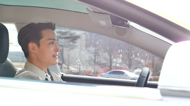 automatic driving electric car - young man driving with smile - shirt and tie stock videos & royalty-free footage