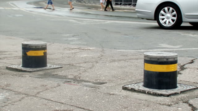 automatic safety barriers on a city street - boundary stock videos & royalty-free footage