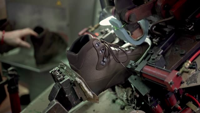 automatic shoe sawing and putting glue - needle plant part stock videos & royalty-free footage