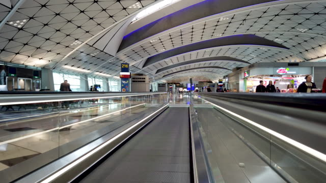 automatic walkway in hong kong airport - diminishing perspective stock videos & royalty-free footage