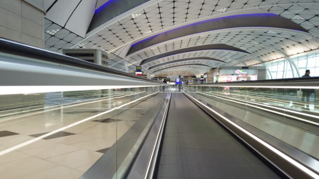 automatic walkway in hong kong airport - vanishing point stock videos and b-roll footage