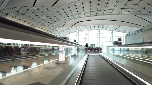 automatic walkway in hong konh airport - building entrance stock videos & royalty-free footage