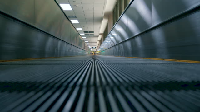 automation moving walkway in the airport - airfield stock videos & royalty-free footage