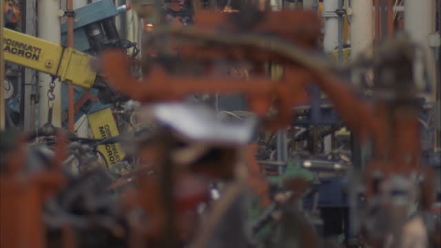 ECU, SELECTIVE FOCUS, Automobile plant, robotics welding on auto assembly line