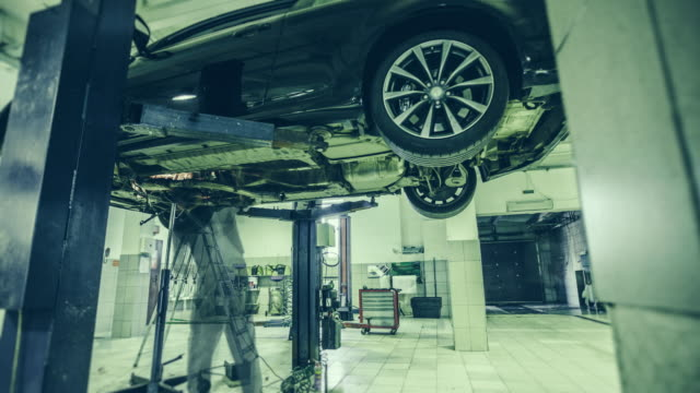 automobile repair shop. 4k time lapse video - repair garage stock videos & royalty-free footage