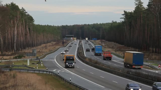 automobiles and freight trucks pass along the berliner ring road near zernsdorf, germany, on thursday, jan. 9 cars and trucks pass along the berliner... - brandenburg state stock videos & royalty-free footage