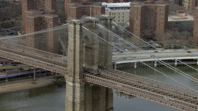 automobiles and pedestrians cross new york's famous brooklyn bridge. - yellow taxi video stock e b–roll