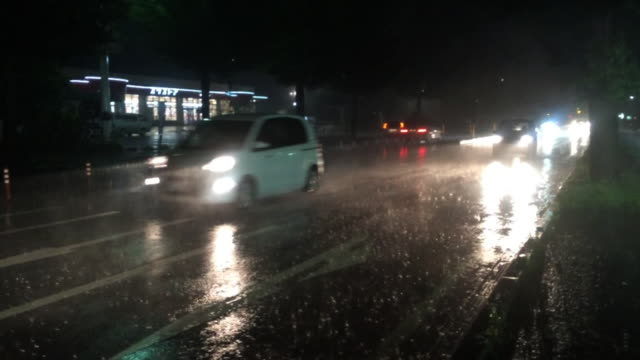 Automobiles In Downpour At Night, Tochigi, Japan