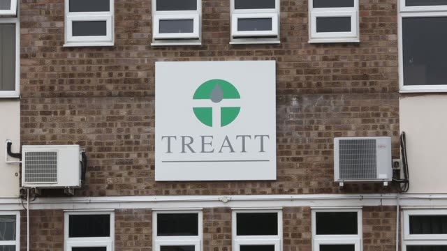 automobiles sit parked outside the treatt plc flavoring and fragrances factory in bury st edmunds uk on wednesday sept 25 a logo sits on display... - bury st edmunds stock videos & royalty-free footage