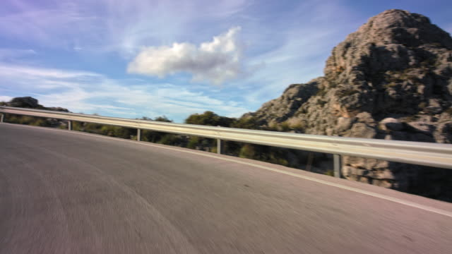 automotive process plate - backplate - background clip / moving scenery matching the drivers pov: driving the scenic, panoramic street ma 10 through serra de tramuntana coming from sa calobra on island of mallorca, north of soller region - sunny day. - safety rail stock videos & royalty-free footage