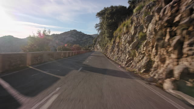 automotive process plate - backplate - background clip / moving scenery matching the drivers pov: driving the scenic, panoramic street ma 10 through serra de tramuntana coming from sa calobra on island of mallorca, north of soller region - sunny day. - car point of view stock videos & royalty-free footage