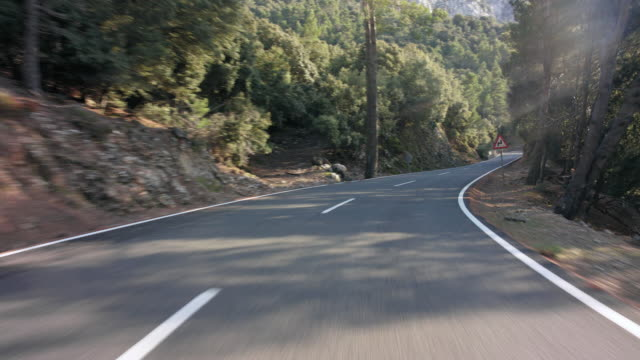 automotive process plate - backplate - background clip / moving scenery matching the drivers pov: driving the scenic, panoramic street ma 10 through serra de tramuntana coming from sa calobra on island of mallorca, north of soller region - sunny day. - curve stock videos and b-roll footage