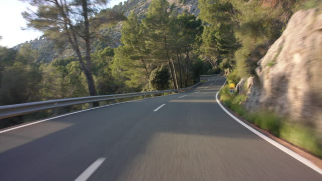 Automotive process plate - backplate - background clip / moving scenery matching the drivers POV: Driving the scenic, panoramic street Ma 10 through Serra de Tramuntana coming from Sa Calobra on island of Mallorca, north of Soller region - sunny day.