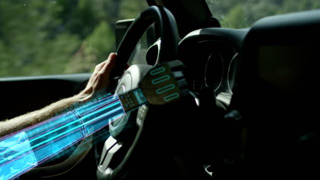 autonomous car. robot hand helping on the car steering wheel. - cyborg video stock e b–roll