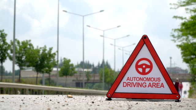 autonomous driving area - traffic sign - driverless transport stock videos & royalty-free footage