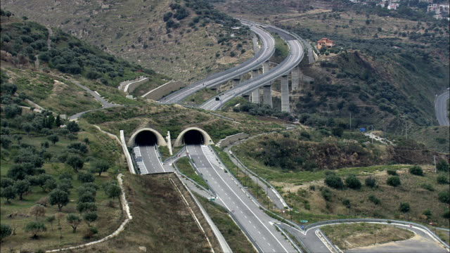 autostrada messina-palermo near canneto  - aerial view - sicily, province of messina, caronia, italy - musical instrument bridge stock videos & royalty-free footage