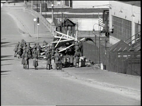 / autoworker's strike at fisher body plant no 2 in flint, michigan in 1937 / national guard lines up tanks in street / military truck goes by as... - ヘンリー・フォード点の映像素材/bロール