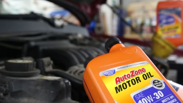 autozone products are displayed in the shop of an auto mechanic in tiskilwa illinois us on friday sept 18 2015 shots close up shots of a can of... - motor oil stock videos & royalty-free footage