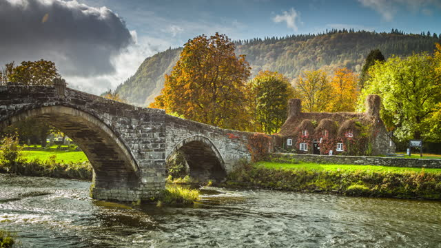 autumn at llanrwst bridge in north wales - scenics stock videos & royalty-free footage