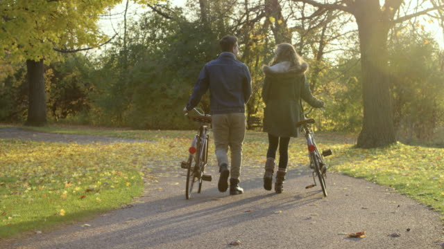 autumn bicycling date - fatcamera stock videos and b-roll footage