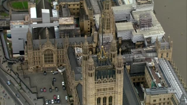 chancellor philip hammond delivers budget speech westminster houses of parliament largely shrouded in scaffolding air view / aerial downing street... - scaffolding stock videos & royalty-free footage