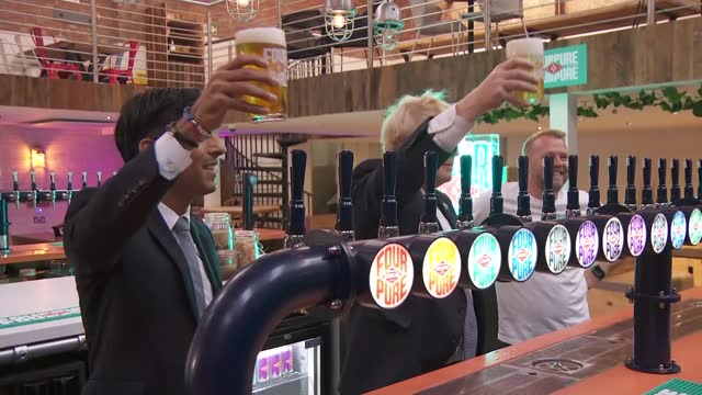 rishi sunak opts to increase public spending; england: int boris johnson mp and rishi sunak mp posing for photocall with pints. - channel 4 news stock videos & royalty-free footage