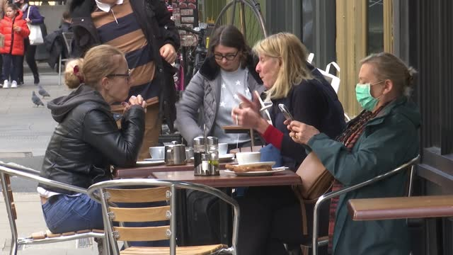 rishi sunak opts to increase public spending; england: london: soho: dean street: the french house: int pub customers in bar chatting and drinking... - itv london tonight stock videos & royalty-free footage
