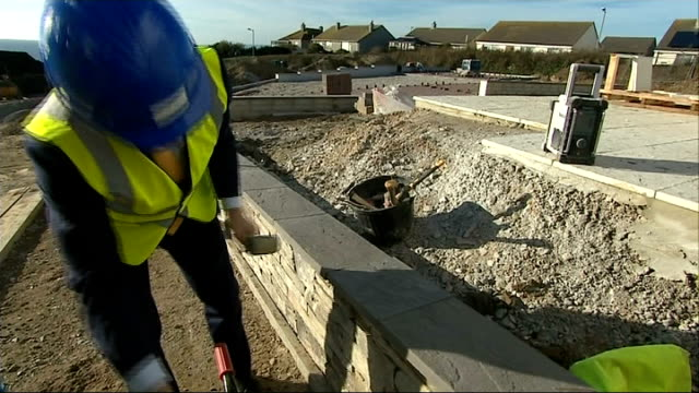 vídeos de stock e filmes b-roll de nick clegg interview england cornwall st austell ext gvs nick clegg mp looking round housing construction site / nick clegg mp interview sot / more... - st austell